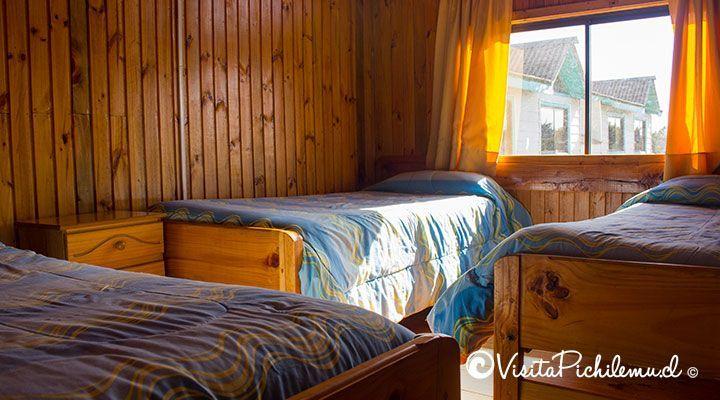 quarto para 3 portas sol cabanas pessoas Pichilemu