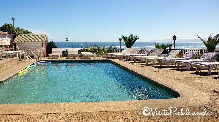 pool overlooking the sea cabanas and Lyon guzman pichilemu